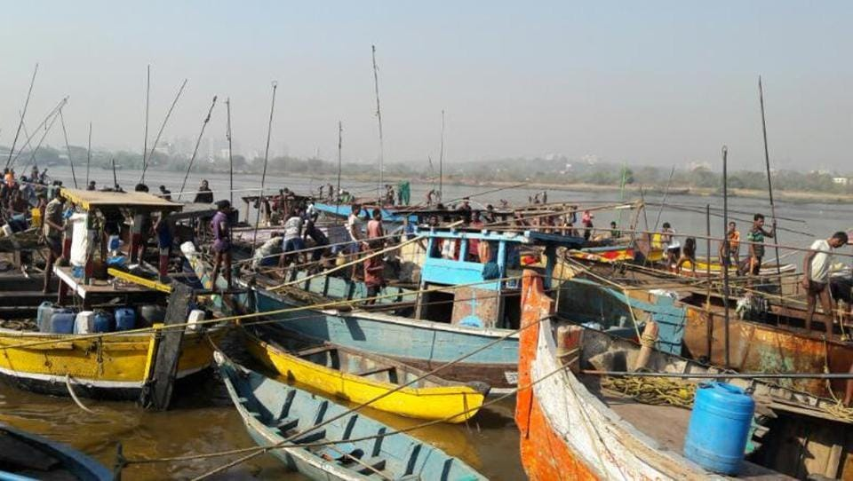 Fishing boats that are normally used for sand mining.