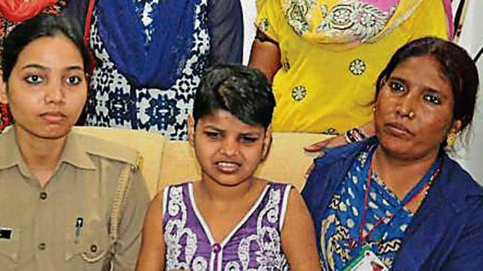 The girl (centre) who was found living with monkeys, at the shelter home in Lucknow.
