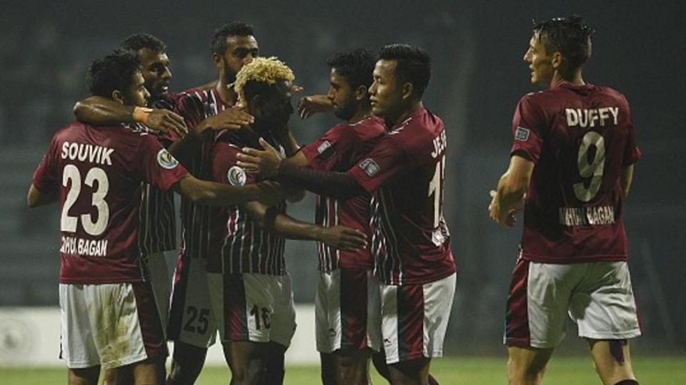 Sony Norde's brilliant strike helped Mohun Bagan beat East Bengal 2-1 in a volatile match in Siliguri and inch closer to the I-League title.