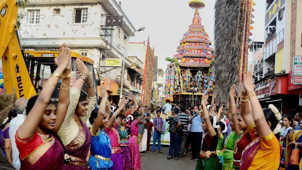 Devotees performing during the annual Panguni celebrations of the Mylapore Sri Kapaleeswarar Temple when a chariot carrying the idol of Lord Shiva is taken out. (PTI)