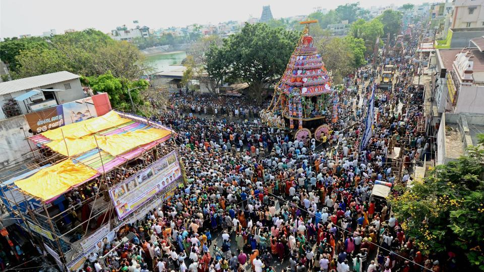 Devotees pull the chariot carrying the idol of Lord Shiva as part of the annual Panguni celebrations of the Sri Kapaleeswarar Temple, in Chennai. (PTI)