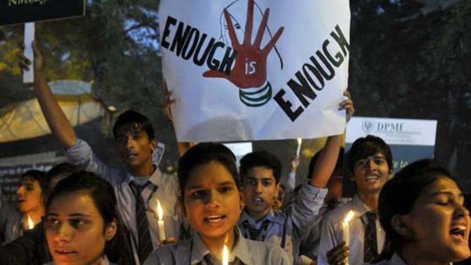 Students-take-part-in-a-candle-light-vigil-at-Jantar-Mantar-New-Delhi-to-commemorate-the-December-16-gang-rape-HT-Photo-Mohd-Zakir