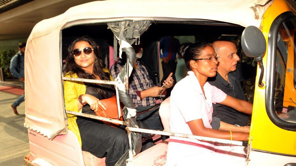 Actress Vidya Balan along with film director and producer Mahesh Bhatt rides a pink auto rickshaw during their visit to state capital for the film
