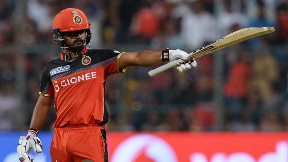 Royal Challengers Bangalore batsman Kedar Jadhav raises his bat after his fifty. (AFP)