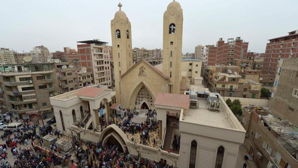 A general view shows people gathering outside the Mar Girgis Coptic Church in the Nile Delta City of Tanta, 120 kilometres (75 miles) north of Cairo, after a bomb blast struck worshippers gathering to celebrate Palm Sunday on April 9, 2017.