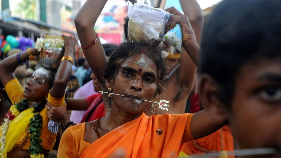Devotees make offerings through sacrificial feats they believe will keep them away from evil spirits. (ARUN SANKAR / AFP)