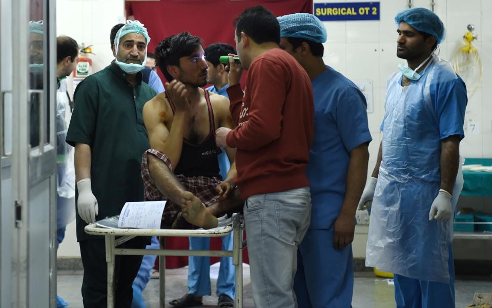 An  injured being examined by medical staff in a ward at a hospital in Srinagar. The violence in the other districts was reported despite stringent security arrangements across the Valley. (Tauseef MUSTAFA / AFP)