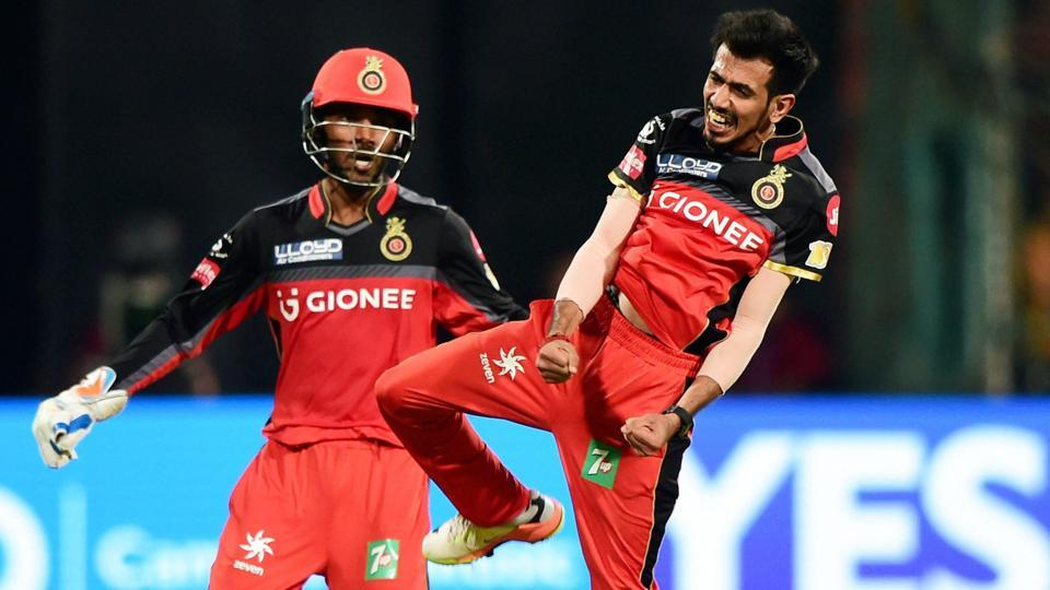 Yuzvendra Chahal celebrates the wicket of Carlos Brathwaite with team mates. (PTI)