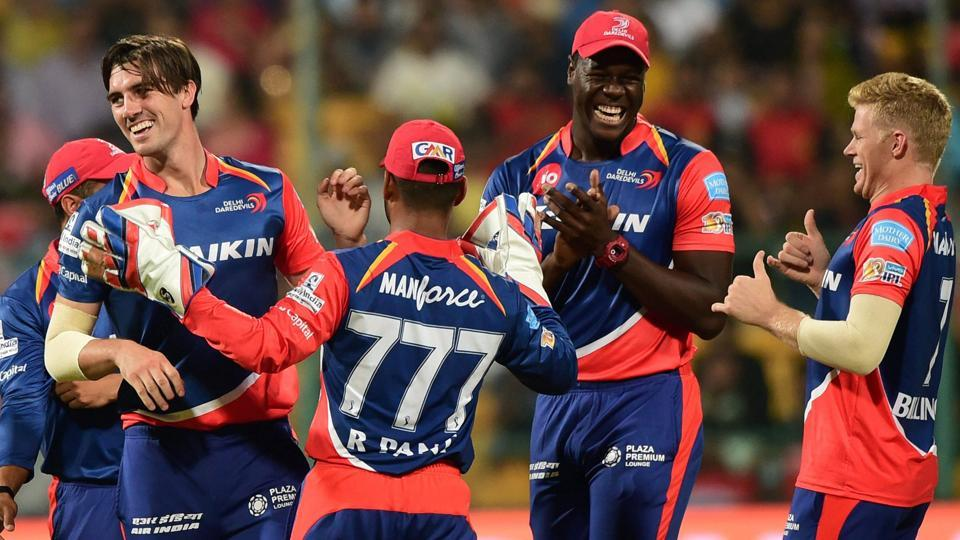 Delhi Daredevils pacer Pat Cummins with teammates celebrate the wicket of Mandeep Singh. (PTI)
