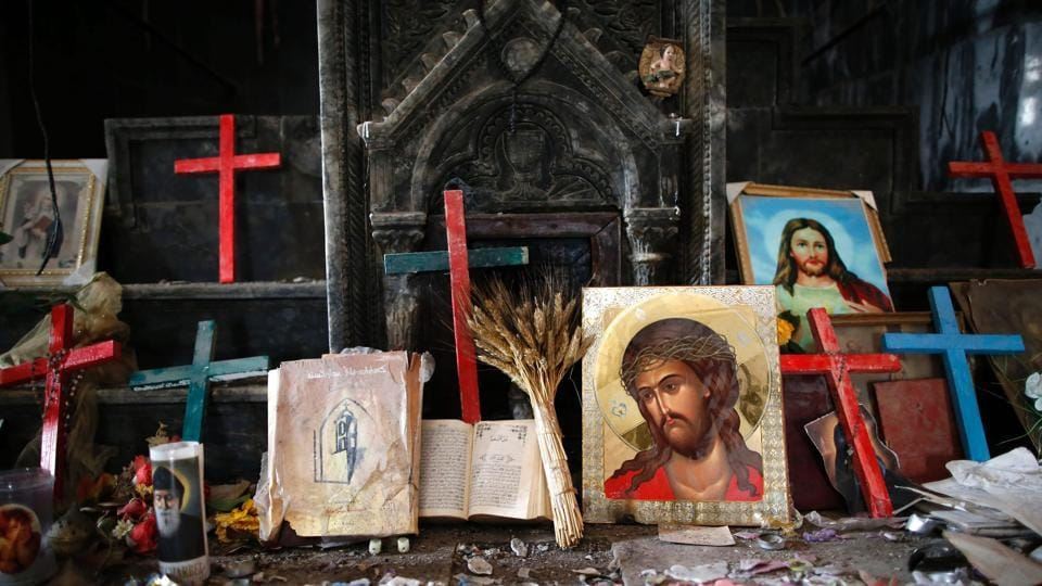 Crucifixes and icons are seen at the heavily damaged Church of the Immaculate Conception in Qaraqosh (also known as Hamdaniya), some 30 kilometres east of Mosul, on April 9, 2017, as Christians mark the first Palm Sunday event in the town since Iraqi forces recaptured it from Islamic State (IS) group jihadists.
