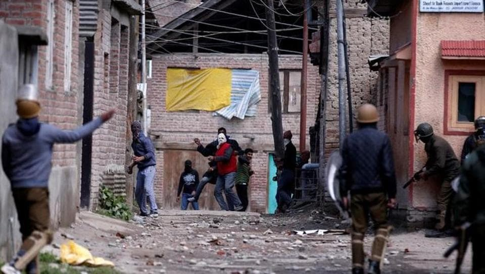 Kashmiri demonstrators (C) throw stones towards Indian policemen during a protest against by-polls in Srinagar April 9, 2017.