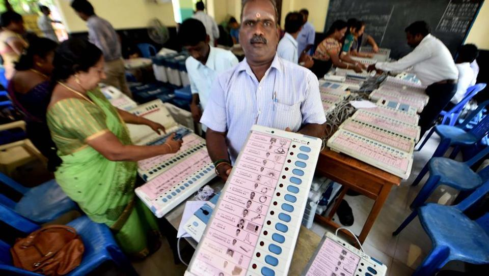 Workers readying EVMs for RK Nagar constituency bypolls in Chennai.