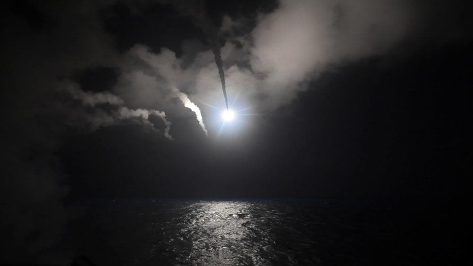 In this file image provided on Friday, April 7, 2017 by the US Navy, the guided-missile destroyer USS Porter (DDG 78) launches a tomahawk land attack missile in the Mediterranean Sea.
