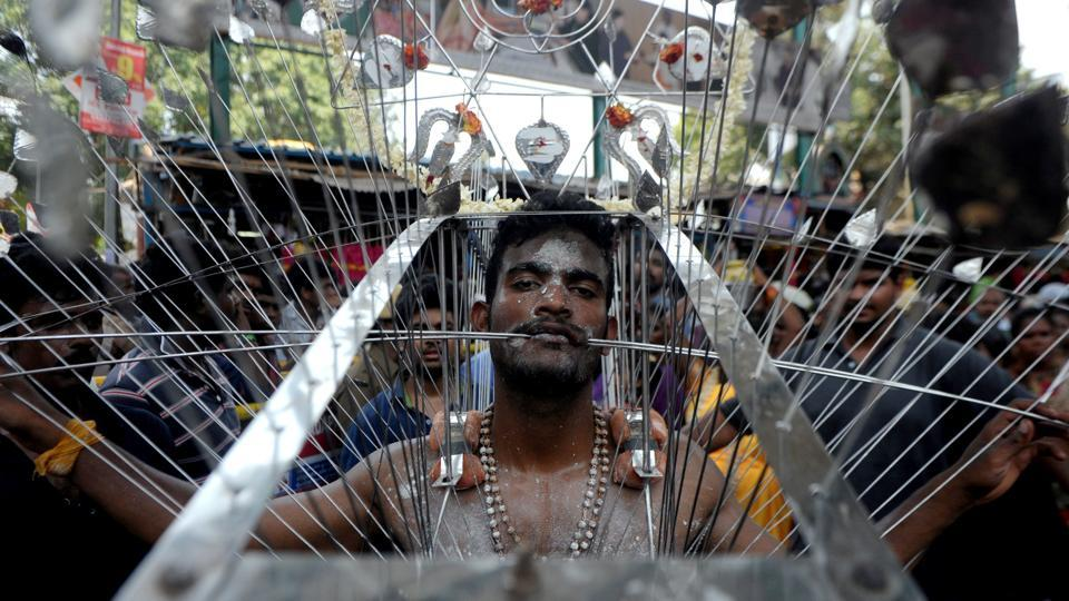 An Indian Hindu devotee, his body pierced with metal skewers, takes part in a procession to mark the Panguni Uthiram festival in Chennai on April 9, 2017.  (ARUN SANKAR / AFP)