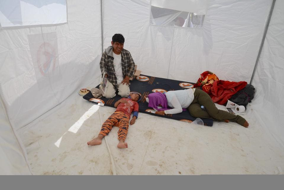 Displaced residents from nearby communities affected by the floods rest at a refugee camp on the outskirts of the northern Peruvian city of Piura, on April, 5, 2017. The