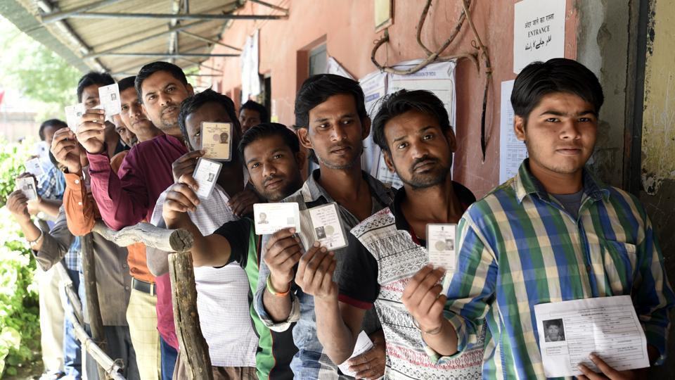 People line up to cast vote during by-election to Rajouri Garden assembly constituency in New Delhi on Sunday.