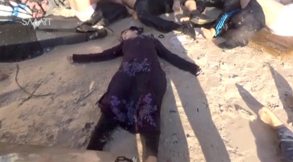 People lying on the ground, said to be in the town of Khan Sheikhoun, after what rescue workers described as a suspected gas attack in rebel-held Idlib, Syria (Social Media Website  / REUTERS)
