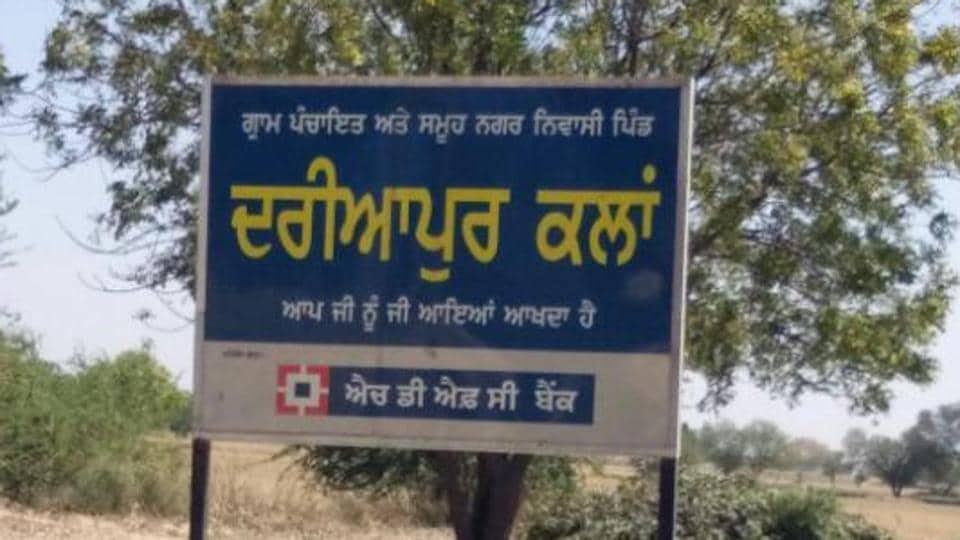 A signboard outside Dariyapur Kalan village in Mansa.