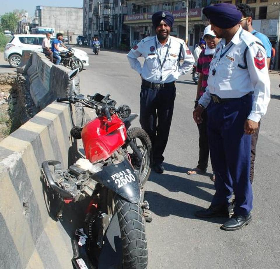 Traffic police officials inspecting the mangled remains of the bike at the accident site in Phagwara on Sunday.