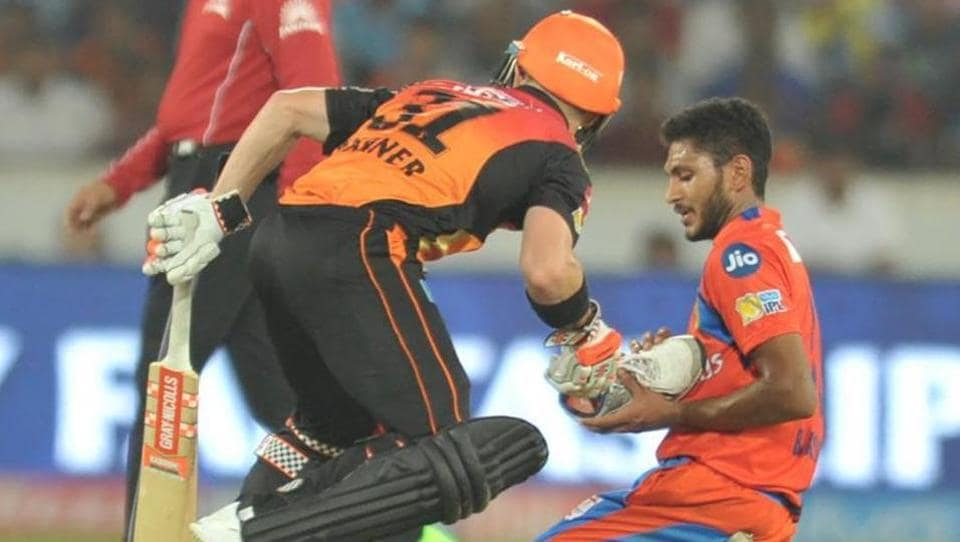David Warner, the Sunrisers Hyderabad captain, hands Gujarat Lions pacer Basil Thampi his shoe during their 2017 Indian Premier League match on Sunday.