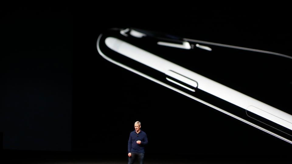 The picture shows Apple CEO Tim Cook unveiling the iPhone 7 and iPhone 7 Plus at the Bill Graham Civic Auditorium in San Francisco.