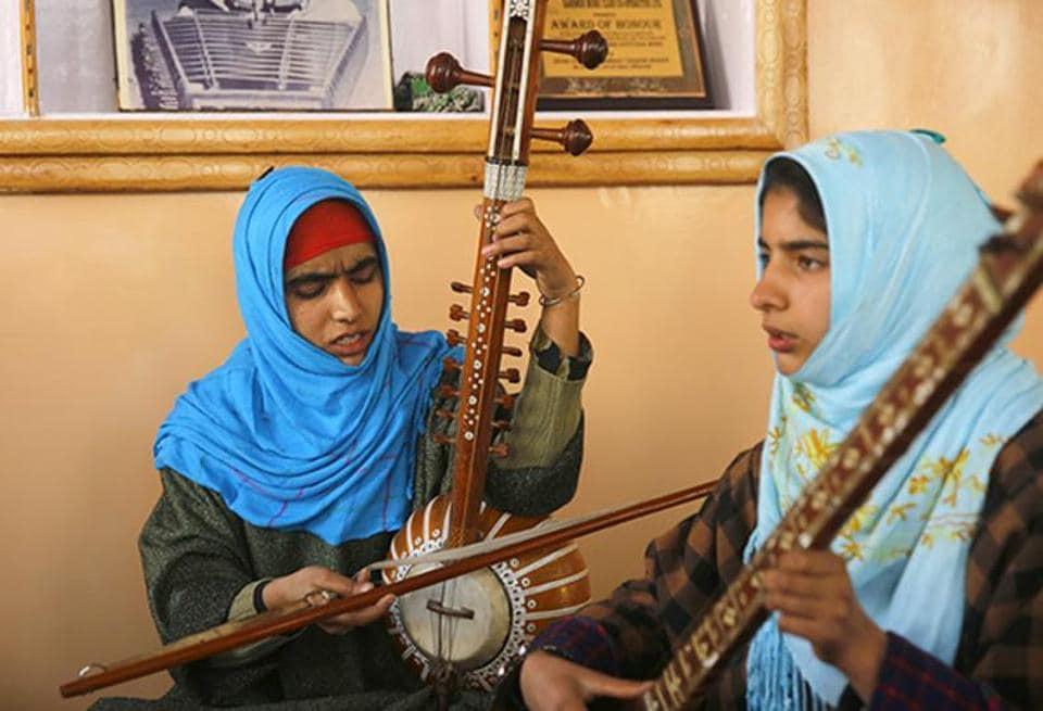 Kashmiri Muslim girls play instruments and sing Sufi music under the tutelage of music teacher, Muhammad Yaqoob Sheikh, on the outskirts of Srinagar.