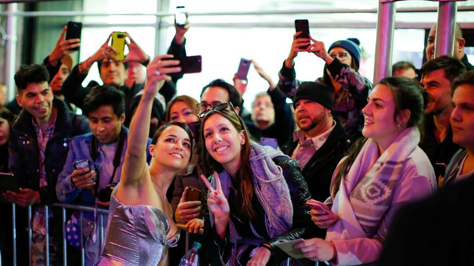 Michelle Rodriguez, who plays Letty in the film, poses for a selfie with fans at the Fate Of The Furious New York premiere. (REUTERS)