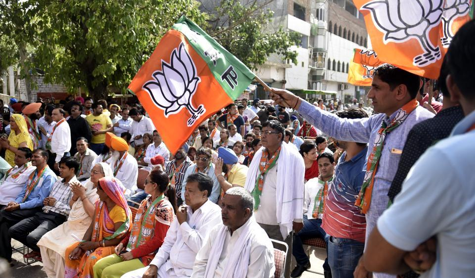 BJP supporters and workers during an election meeting at Khayala. The property and assets declared by the party's Inderpuri candidate, Sunita Kaushik, who was earlier claimed to be a slum dweller, has stirred a controversy.