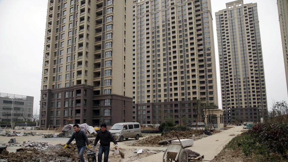 Workers at a newly-built condominium complex where a controversial mosque is planned in Hefei in central China's Anhui province.