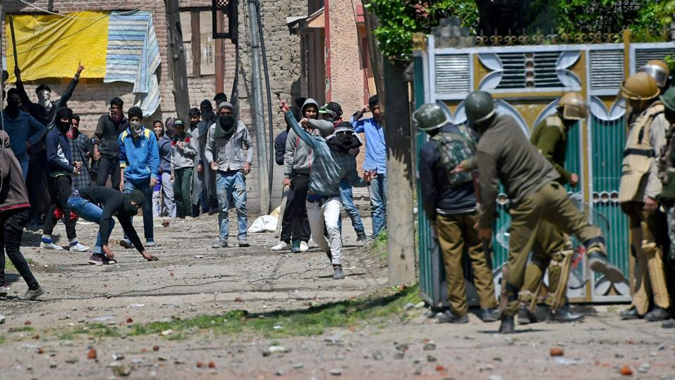 People throw stones on security forces during clashes in Srinagar.
