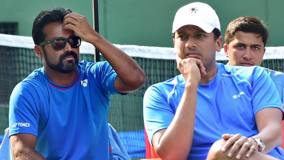 Mahesh Bhupathi (R) and Leander Paes look on during the Davis Cup tie between India and Uzbekistan.