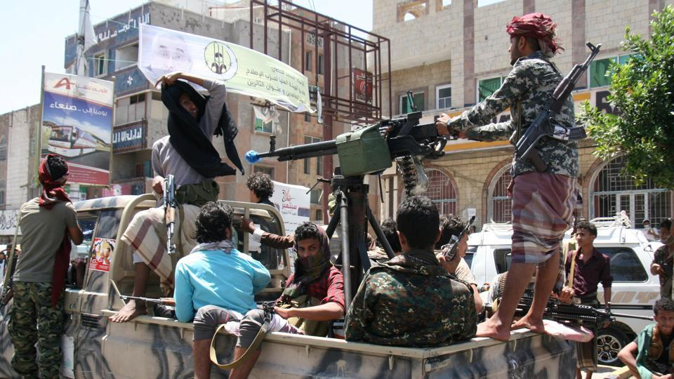 Pro-government tribal fighters patrol a street during a visit by a UN delegation in the war-torn southwestern city of Taiz, Yemen April 9, 2017.