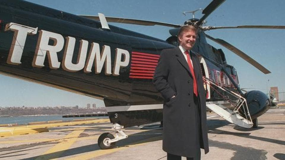 In this March 1988 file photo, Donald Trump stands next to one of his three Sikorsky helicopters at the New York Port Authority's West 30th Street Heliport in New York.