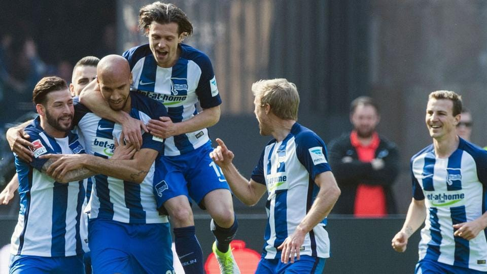 Hertha Berlin players celebrate after US defender John Anthony Brooks (second from left) scored the opening goal during their Bundesliga match against FC Augsburg in Berlin on Saturday.