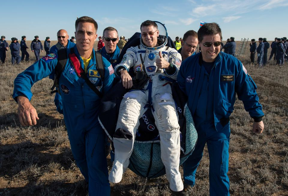 Ground personnel carry International Space Station (ISS) crew member and NASA astronaut Shane Kimbrough shortly after the landing of Russia's Soyuz MS-02 space capsule near the town of Dzhezkazgan (Zhezkazgan), Kazakhstan. Three space fliers have safely touched down on Earth after almost six months aboard the International Space Station. (Bill Ingalls/NASA / REUTERS)