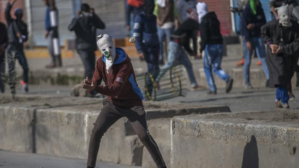 A masked Kashmiri protester during a protest in Srinagar. Security personnel fire tear gas and pellet guns to disperse protests in Kashmir valley.