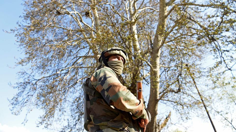An Indian army soldier stands guard near the scene of an attack on a Indian Central Reserve Police Force (CRPF) convoy at Panthachowk on the outskirts of Srinagar on April 3, 2017.