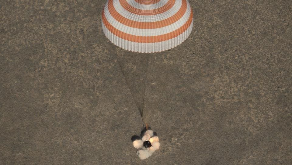 he Russian Soyuz capsule carrying the International Space Station's Expedition 50 crew lands safely in the steppes of Kazakhstan. (Kirill Kudryavtsev/Pool / AFP)