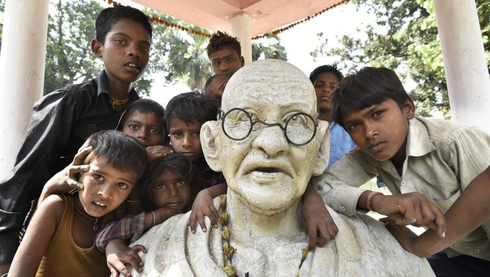 Children gather around Mahatma Gandhi's statue at Chanderahia  Village, Bihar.  A few hours of detention in Champaran paved the way for Mohandas Karamchand Gandhi to turn into the Mahatma.