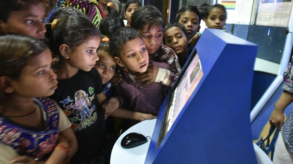 Children look at an interactive touch screen at the digital information gallery of Nehru Planetarium. (Raj K Raj/HT PHOTO)
