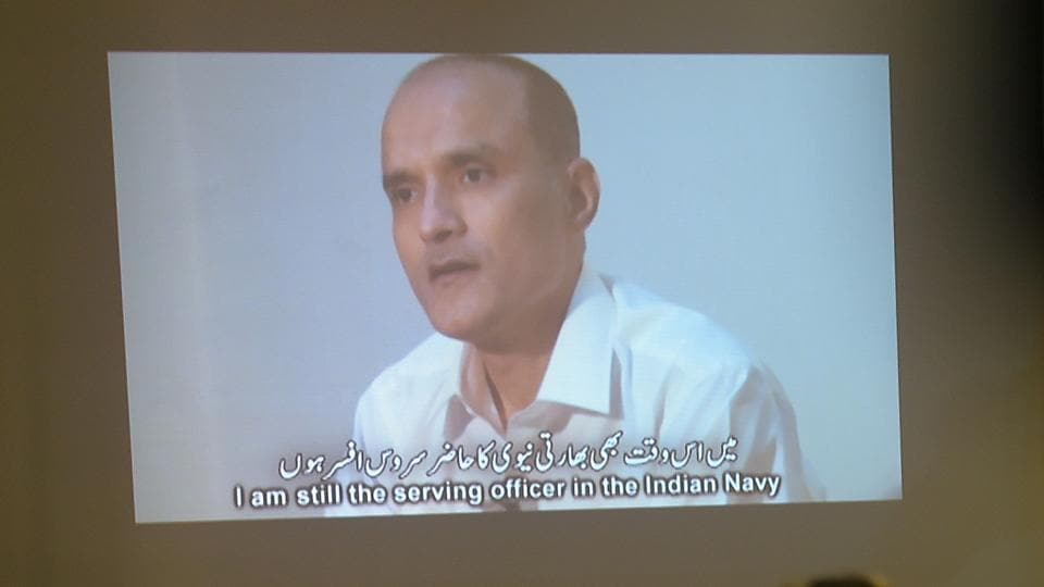 In this file photo, Pakistani journalists watch a video showing Indian national Kulbhushan Yadav, arrested on suspicion of spying, during a press conference in Islamabad.