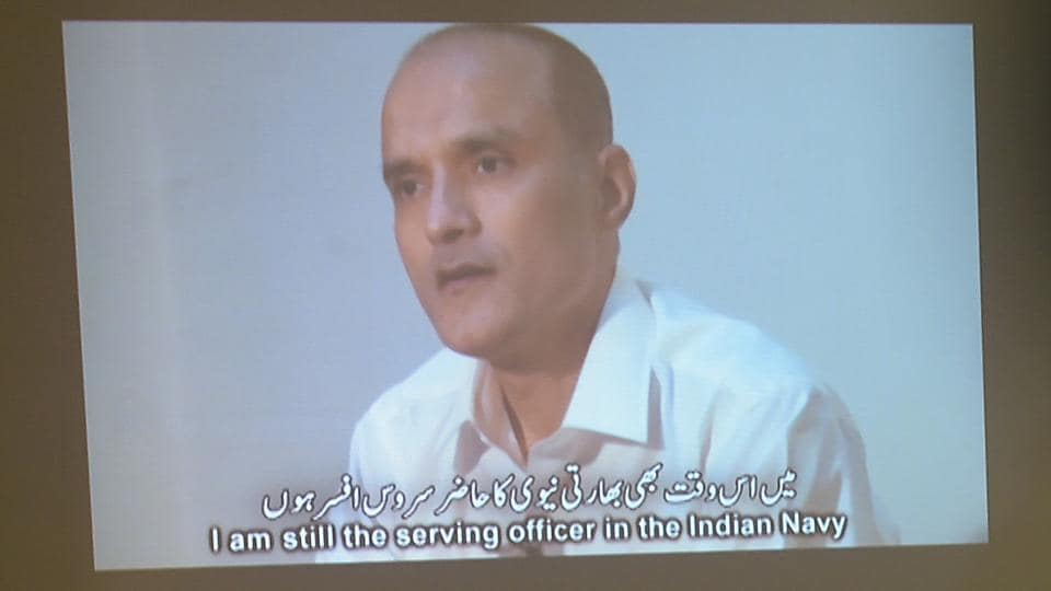 Pakistani journalists watch a video showing Kulbhushan Yadav, arrested on suspicion of spying, during a press conference in Islamabad in March 2016.