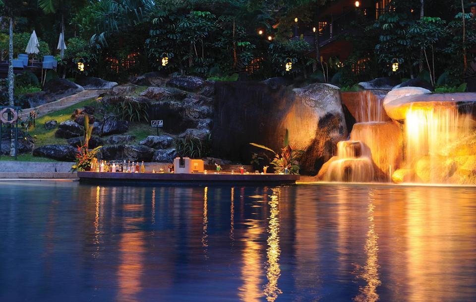 The pool bar and artificial waterfall at Purvankara's Purva Palm Beach project in Bengaluru.