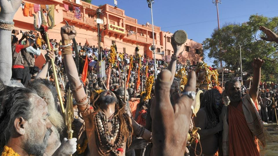Sadhus get ready for a dip at Ujjain during Simhastha Kumbh