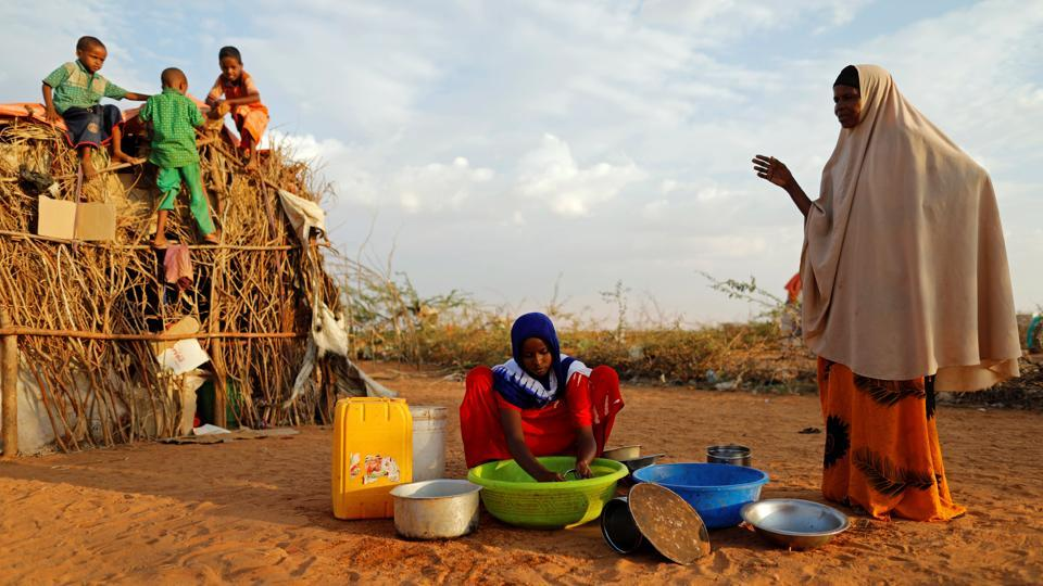 Zeinab, 14, (C) washes dishes as her mother Abdir Hussein gestures and her nephews play. It extends from the red soil of Nigeria in the west, where Boko Haram's six-year jihadist insurgency has forced 2 million people to flee their homes, to Yemen's white deserts in the east, where warring factions block aid while children starve. (Zohra Bensemra/REUTERS)