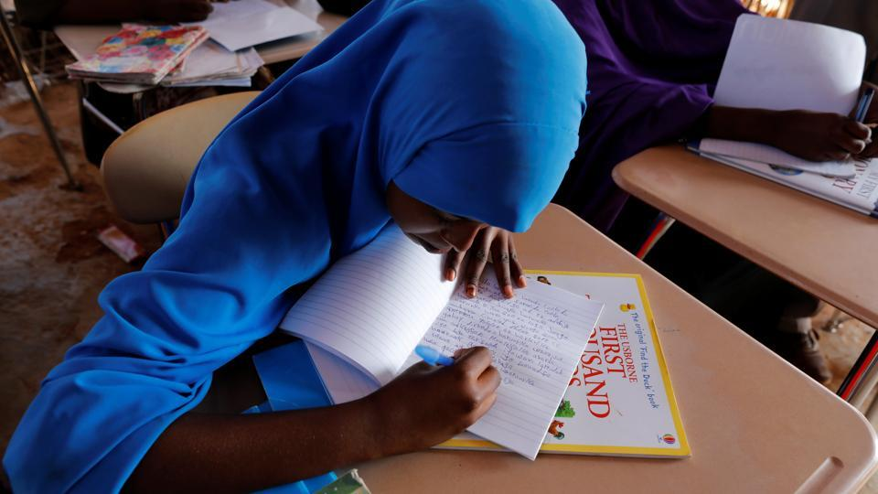Zeinab, 14, writes in class at a school near a camp. Parts of South Sudan are already suffering famine, the first in six years. (Zohra Bensemra/REUTERS)