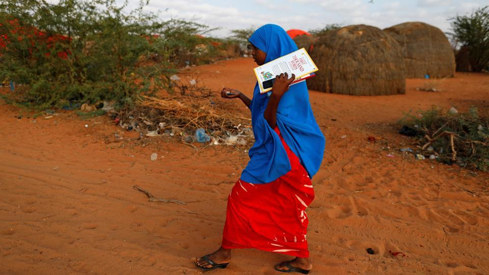 Zeinab, 14, walks to school at a camp for internally displaced people from drought hit areas in Dollow. In Somalia, the United Nations says more than half the 12 million population need aid.  (Zohra Bensemra/REUTERS)
