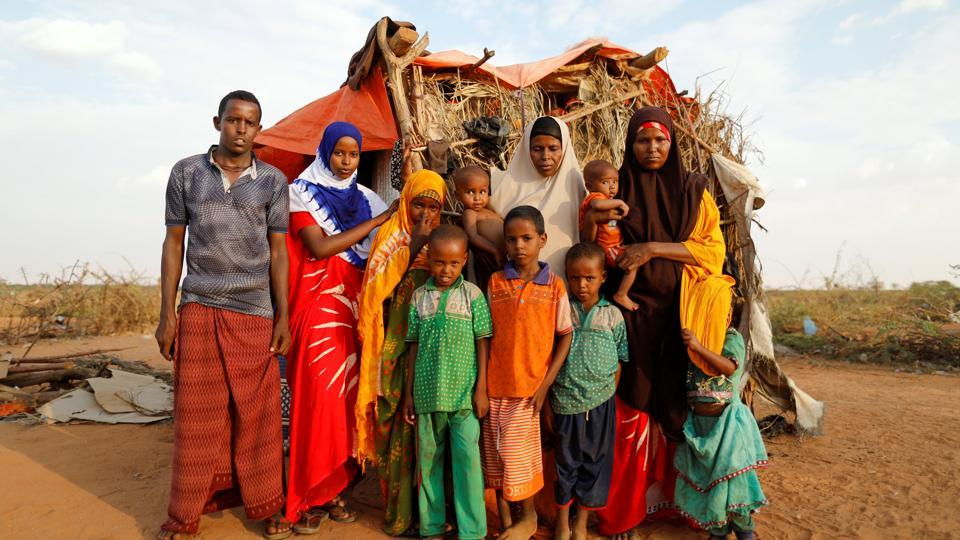 Zeinab, 14, (2nd L) poses for photograph with her family beside their shelter. Weighed against Zeinab's dreams were the lives of 20 nieces and nephews, the sons and daughters of her three elder sisters, all married young and all widowed or divorced. There was also her careworn older brother, her gap-toothed younger sister and her middle-aged parents. (Zohra Bensemra/REUTERS)