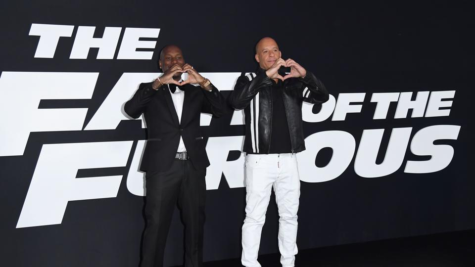 Actors Tyrese Gibson and Vin Diesel make heart gestures at the premiere of Universal Pictures' The Fate Of The Furious at Radio City Music Hall in New York City. (AFP)