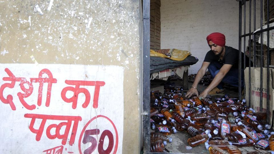 Around two dozen cartons of liquor bottles were taken out and thrown on the road. The bottles were smashed with batons and later set afire.